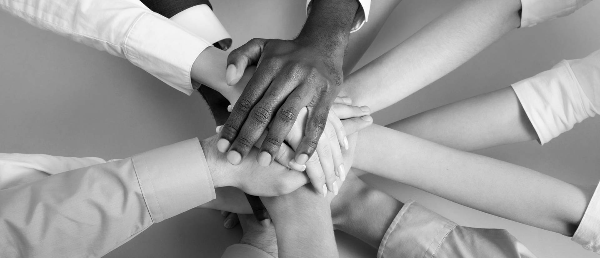 Hands together in a huddle