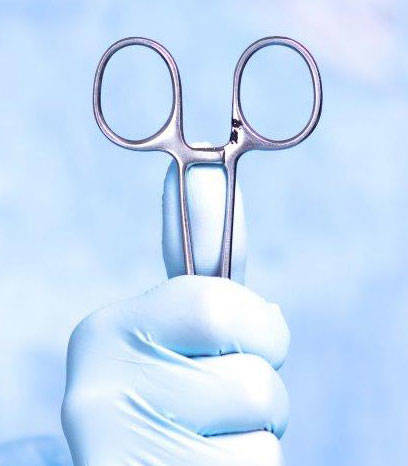 Surgical hand holding scissors with a pit in it