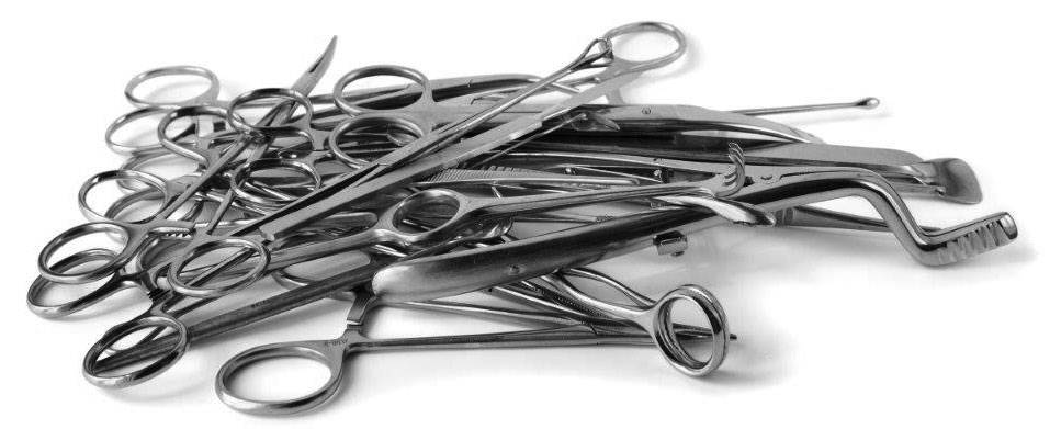 Pile of surgical instruments that need repair